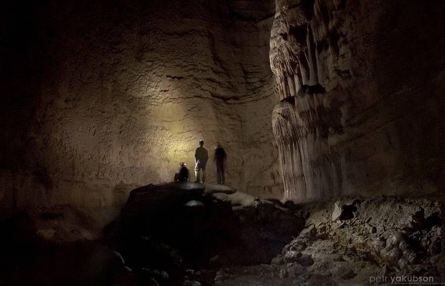 "Researchers stand in the ""Classic Hall,"" where Russia's Kinderlinskaya Cave opens up to a large cylindrical cavern, during field work in July 2012. UNLV doctoral student Jonathan Baker hopes to co ..."