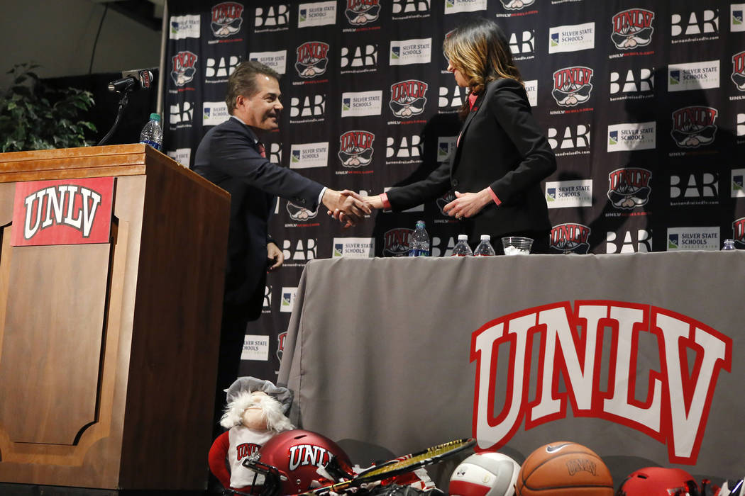 UNLV's President Len Jessup, from left, and Desiree Reed-Francois shakes hands at the Thomas & Mack Center during a press conference where Reed-Francois was announced as the university's new a ...