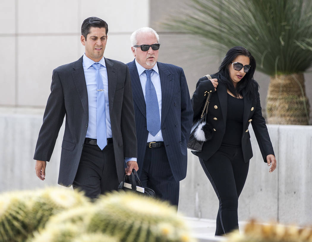 Rick Rizzolo, center, the former owner of Crazy Horse Too, walks into the Federal Courthouse to plead guilty on Wednesday, May 31, 2017. Patrick Connolly Las Vegas Review-Journal @PConnPie