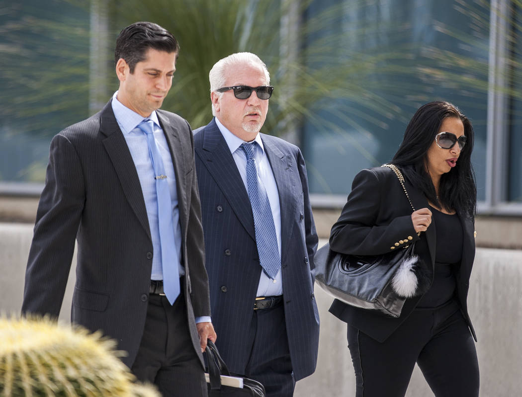 Rick Rizzolo, center, the former owner of Crazy Horse Too, center, walks into the Federal Courthouse to plead guilty on Wednesday, May 31, 2017. Patrick Connolly Las Vegas Review-Journal @PConnPie