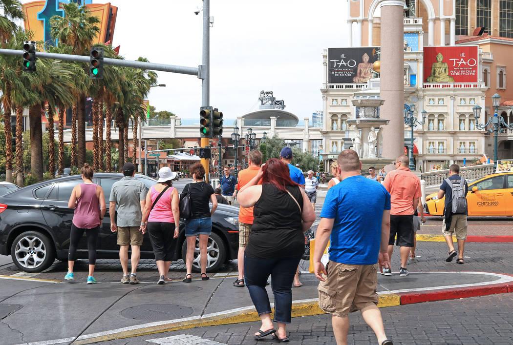 Tourists cross the street in front of the Venetian hotel-casino, Wednesday, May 31, 2017. Gabriella Benavidez Las Vegas Review-Journal @latina_ish