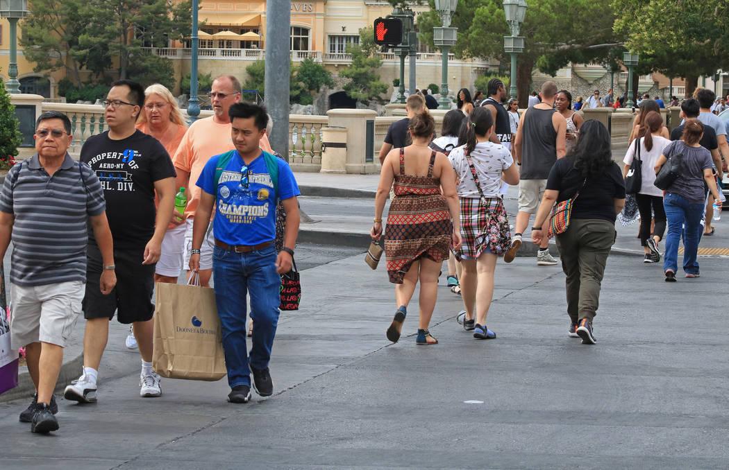 Tourists cross the street near the Bellagio hotel-casino and CityCenter, Wednesday, May 31, 2017. Gabriella Benavidez Las Vegas Review-Journal @latina_ish