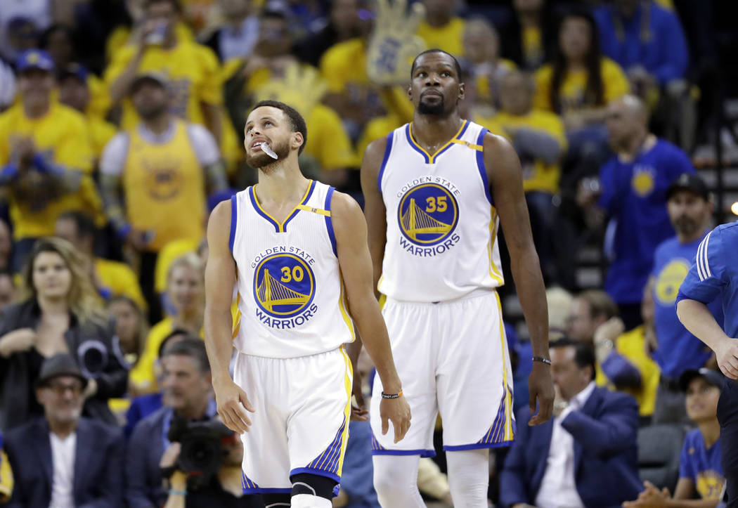 Golden State Warriors' Stephen Curry (30) and Kevin Durant during the second half of Game 2 of the NBA basketball Western Conference finals against the San Antonio Spurs, Tuesday, May 16, 2017, in ...