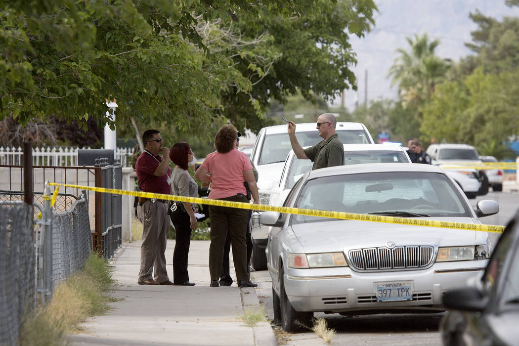 Police are present at the 2800 block of Holmes Street on Tuesday, May 30, 2017, in North Las Vegas.  One man was declared dead outside a parked car in the residential area.  Bridget Bennett Las Ve ...