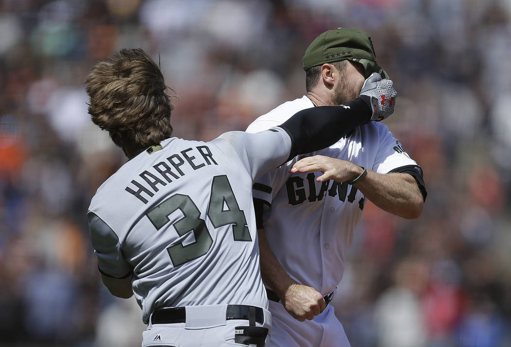 Washington Nationals' Bryce Harper (34) hits San Francisco Giants' Hunter Strickland in the face after being hit with a pitch in the eighth inning of a baseball game Monday, May 29, 2017, in San F ...