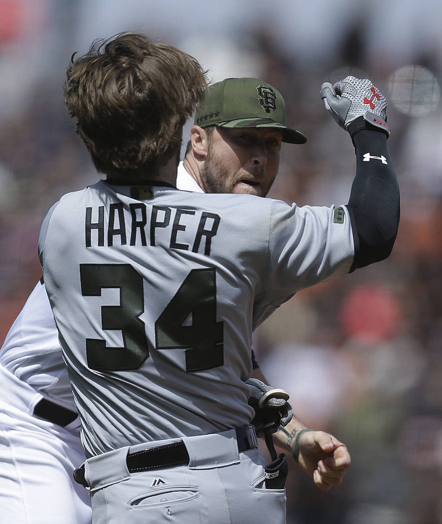 Washington Nationals' Bryce Harper (34) charges San Francisco Giants' Hunter Strickland after being hit with a pitch in the eighth inning of a baseball game Monday, May 29, 2017, in San Francisco. ...