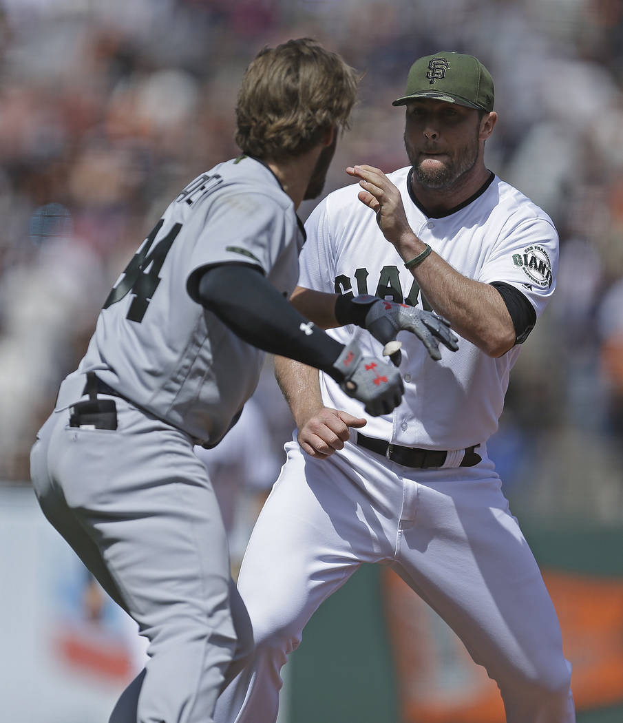 Washington Nationals' Bryce Harper, left, charges San Francisco Giants' Hunter Strickland after being hit with a pitch in the eighth inning of a baseball game Monday, May 29, 2017, in San Francisc ...