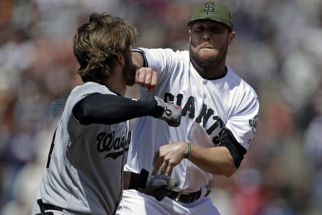 Washington Nationals' Bryce Harper, left, prepares to hit San Francisco Giants' Hunter Strickland after being hit with a pitch in the eighth inning of a baseball game Monday, May 29, 2017, in San  ...