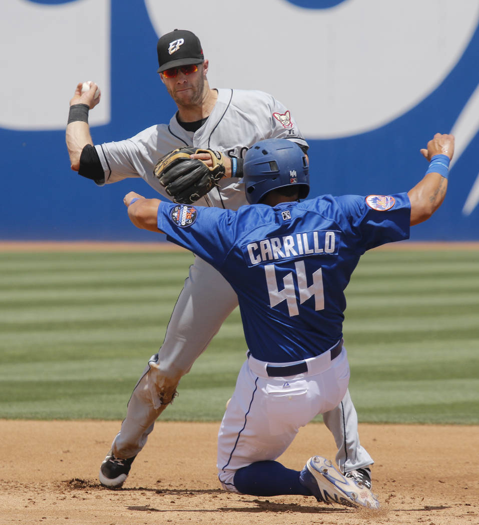 El Paso Chihuahuas' Dusty Coleman throws to first base after getting Las Vegas 51s' Xorge Carrillo (44) out at second base during a baseball game at Cashman Field in Las Vegas on Tuesday, May 30,  ...
