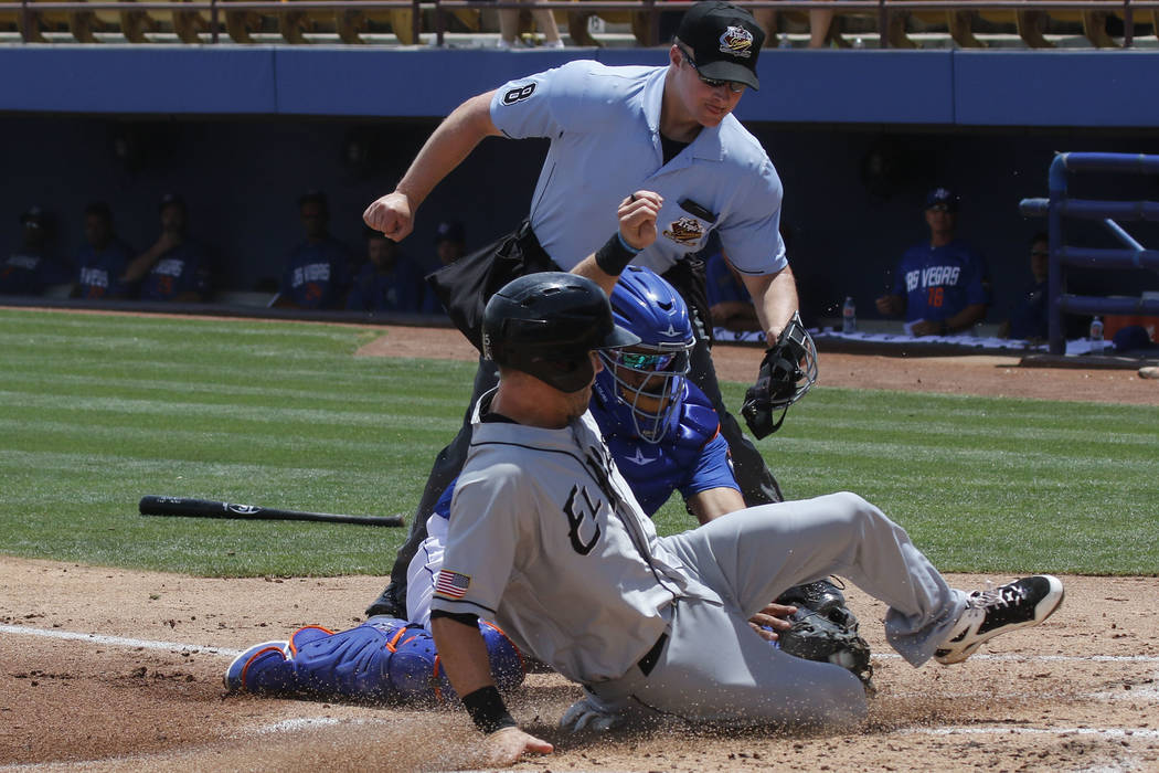 El Paso Chihuahuas' Dusty Coleman scores a run against Las Vegas 51s' catcher Xorge Carrillo during a baseball game at Cashman Field in Las Vegas on Tuesday, May 30, 2017. Chase Stevens Las Vegas  ...