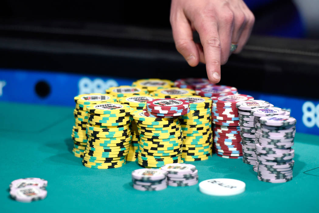 Qui Nguyen's chips are counted after suspension of play during the final table of the Main Event at the World Series of Poker at the Rio hotel-casino, Monday, Oct. 31, 2016, in Las Vegas. David Be ...
