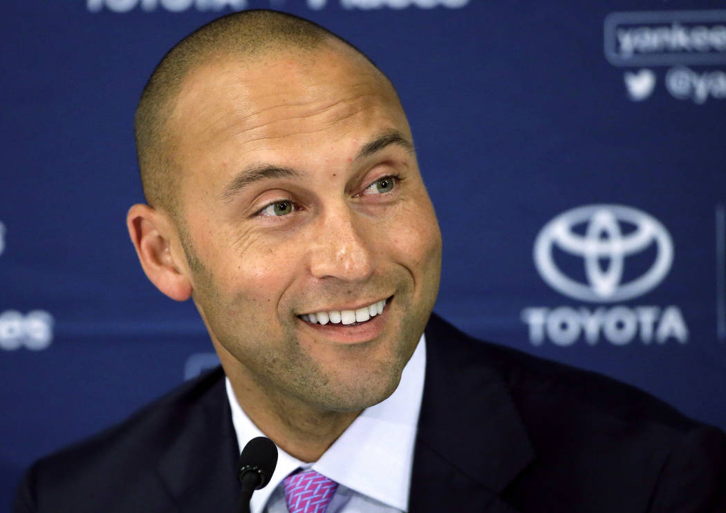 In this Sept. 28, 2014, file photo, New York Yankees' Derek Jeter speaks to the media after the last baseball game of his career, against the Boston Red Sox, at Fenway Park in Boston. (AP Photo/St ...