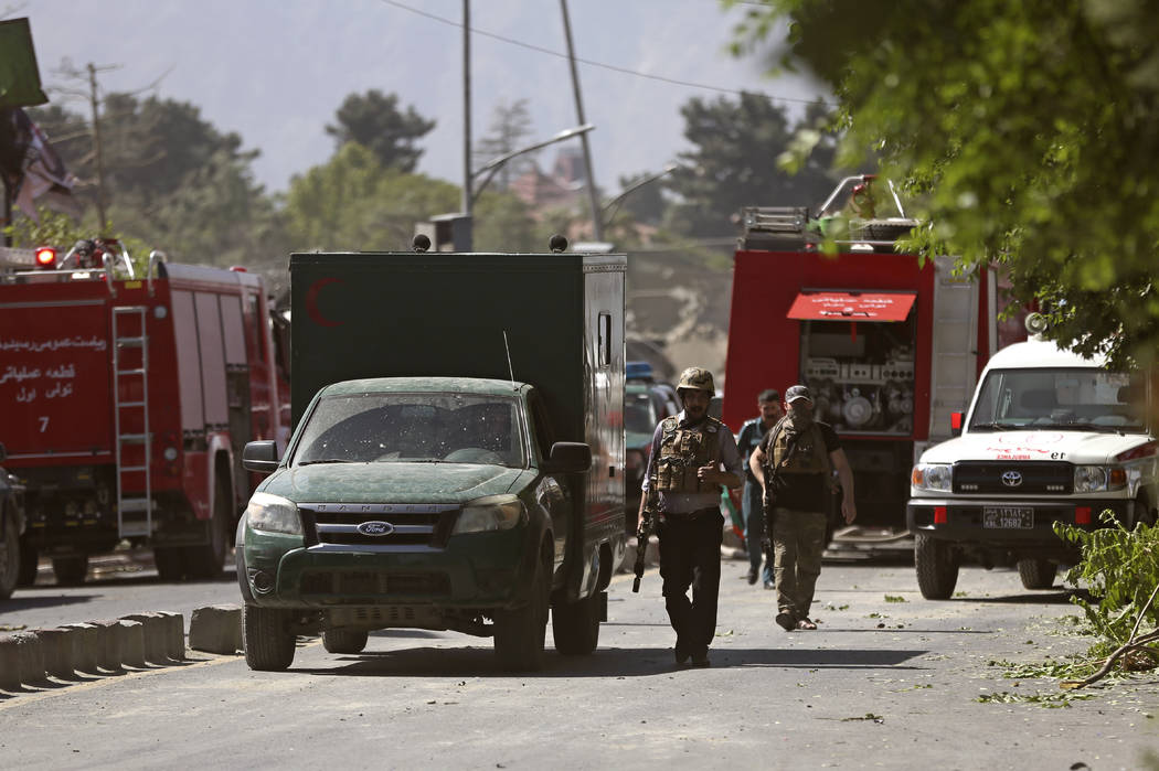 Security forces inspect near the site of an explosion in Kabul, Afghanistan, Wednesday, May 31, 2017.  A massive explosion rocked a highly secure diplomatic area of Kabul on Wednesday morning, cau ...