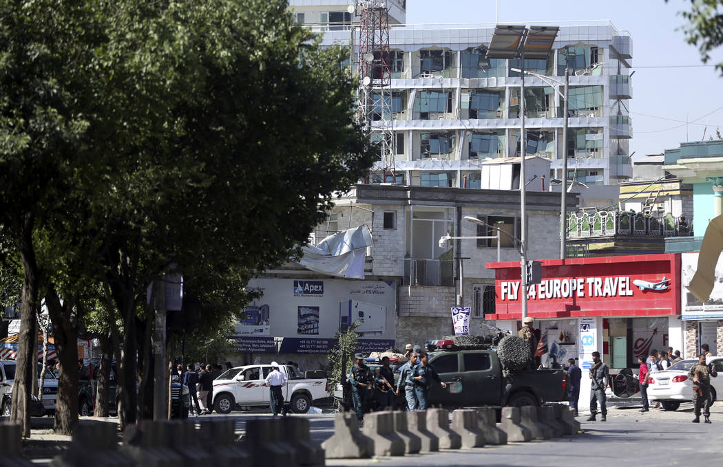 Security forces inspect near the site of an explosion in Kabul, Afghanistan, Wednesday, May 31, 2017. A massive explosion rocked a highly secure diplomatic area of Kabul on Wednesday morning, caus ...