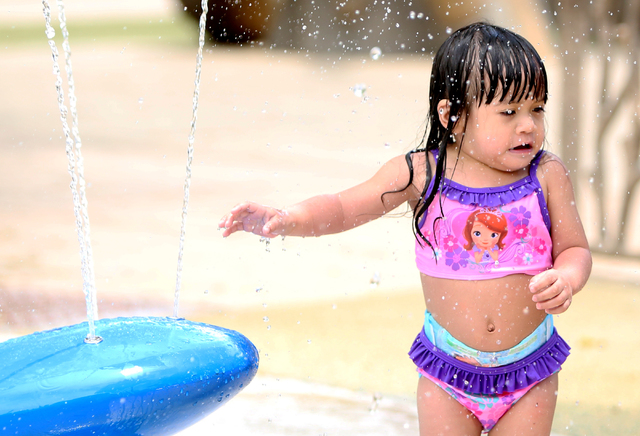 Faith Mena-Gutlay, 2, cools herself as she plays at Sunset Park during a hot day. High temperatures will continue in the Las Vegas Valley the rest of this week. (Bizuayehu Tesfaye/Las Vegas Review ...