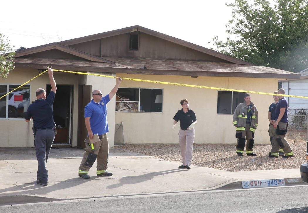 Henderson firefighters investigate the scene of a house fire that killed a man on the 200 block of West Basic Road on Tuesday, May 30, 2017, in Henderson. (Bizuayehu Tesfaye/Las Vegas Review-Journ ...
