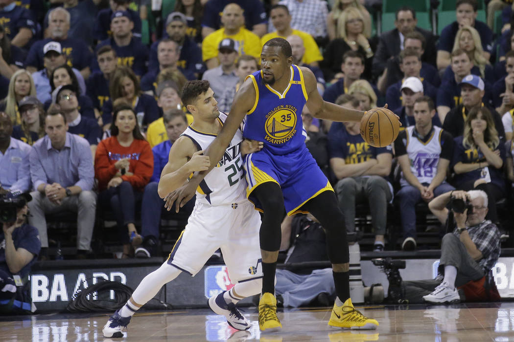 Utah Jazz guard Raul Neto (25) guards Golden State Warriors forward Kevin Durant (35) in the second half during Game 4 of the NBA basketball second-round playoff series Monday, May 8, 2017, in Sal ...
