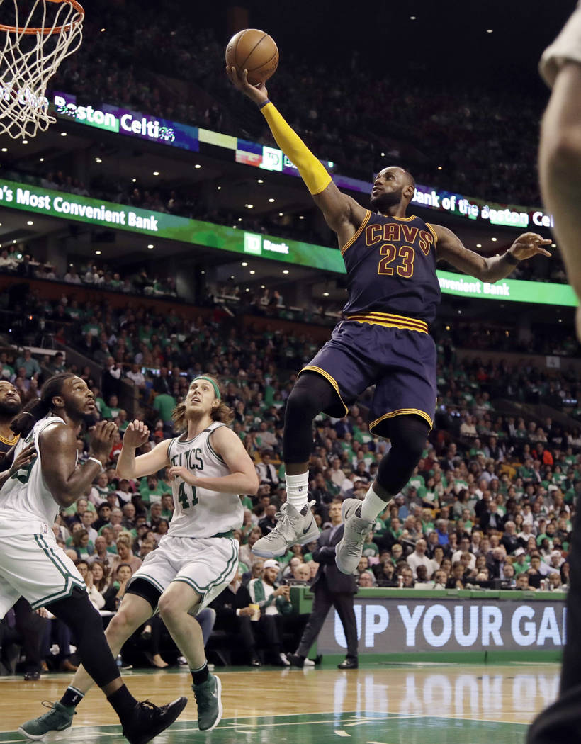 In this May 25, 2017, file photo, Cleveland Cavaliers forward LeBron James (23) soars to the basket over Boston Celtics forward Jae Crowder, left, and center Kelly Olynyk (41) during the second ha ...