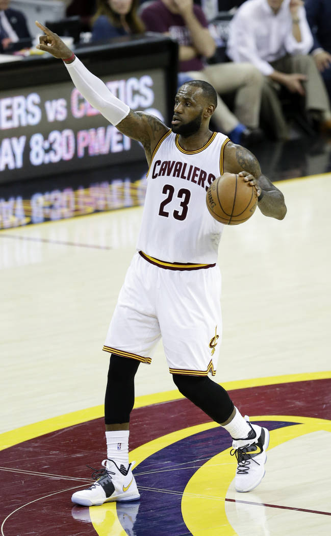 Cleveland Cavaliers' LeBron James (23) brings the ball up the floor against the Boston Celtics during the second half of Game 4 of the NBA basketball Eastern Conference finals, Tuesday, May 23, 20 ...