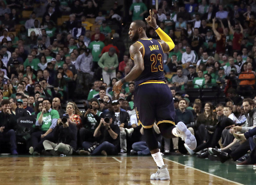 Cleveland Cavaliers forward LeBron James celebrates after sinking a three point shot during the second half of Game 5 of the NBA basketball Eastern Conference finals against the Boston Celtics, on ...