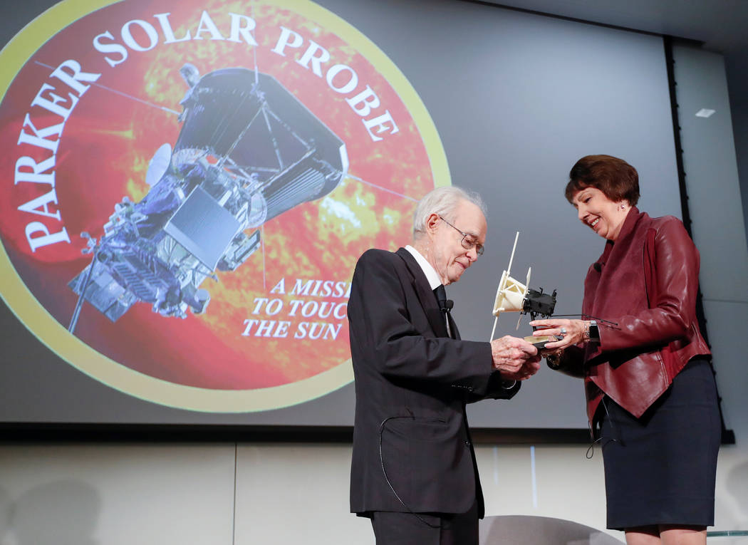 Dr. Eugene Parker, University of Chicago astrophysicist, (L), receives a first scale model of Parker Solar Probe from Dr. Nicola Fox, project scientist for the Solar Probe Plus, (R), during the NA ...