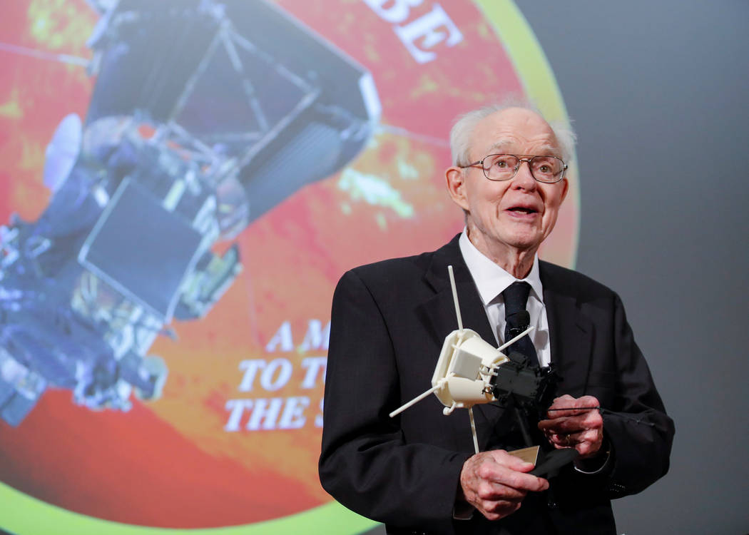 Dr. Eugene Parker, University of Chicago astrophysicist, smiles after receiving a first scale model of Parker Solar Probe during the NASA announcement on its first mission to fly directly into the ...