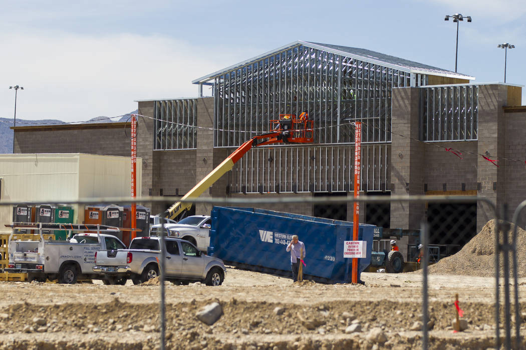 The shopping center where a Sprouts, under construction in the background, is slated to open in the second half of the year at 8441 Farm Road, near the intersection with Tule Springs Road, in nort ...