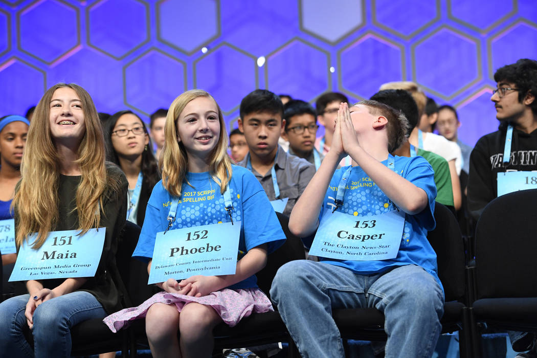Casper Smith (NC), right,  spelled the word plesiobiosis (the association of insect colonies) correctly during the 2017 Scripps National Spelling Bee at the Gaylord National Resort and Convention  ...