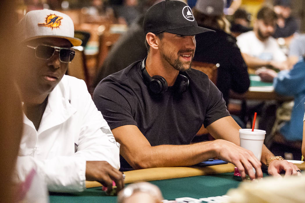 Olympic swimmer Michael Phelps plays poker during a tag team event in the opening of the World Series of Poker at the Rio Convention Center on Wednesday, May 31, 2017. Patrick Connolly Las Vegas R ...