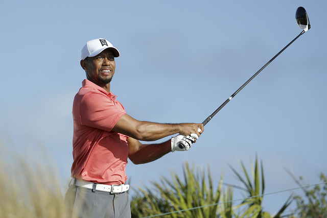 Tiger Woods watches his tee shot on the fourth hole during the Pro-Am at the Hero World Challenge golf tournament, Wednesday, Nov. 30, 2016, in Nassau, Bahamas. (Lynne Sladky/AP)