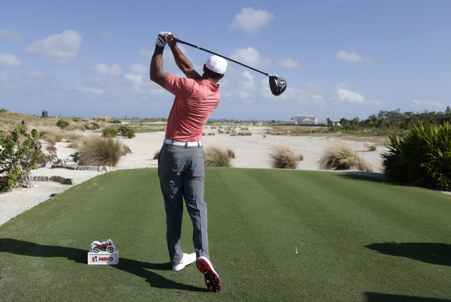 Tiger Woods hits from the sixth tee during the Pro-Am at the Hero World Challenge golf tournament, Wednesday, Nov. 30, 2016, in Nassau, Bahamas. (Lynne Sladky/AP)