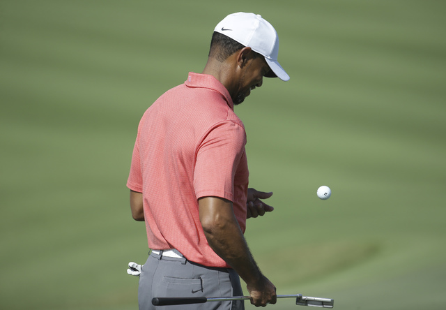 Tiger Woods bounces a golf ball on the 16th hole during the Pro-Am at the Hero World Challenge golf tournament, Wednesday, Nov. 30, 2016, in Nassau, Bahamas. (Lynne Sladky/AP)