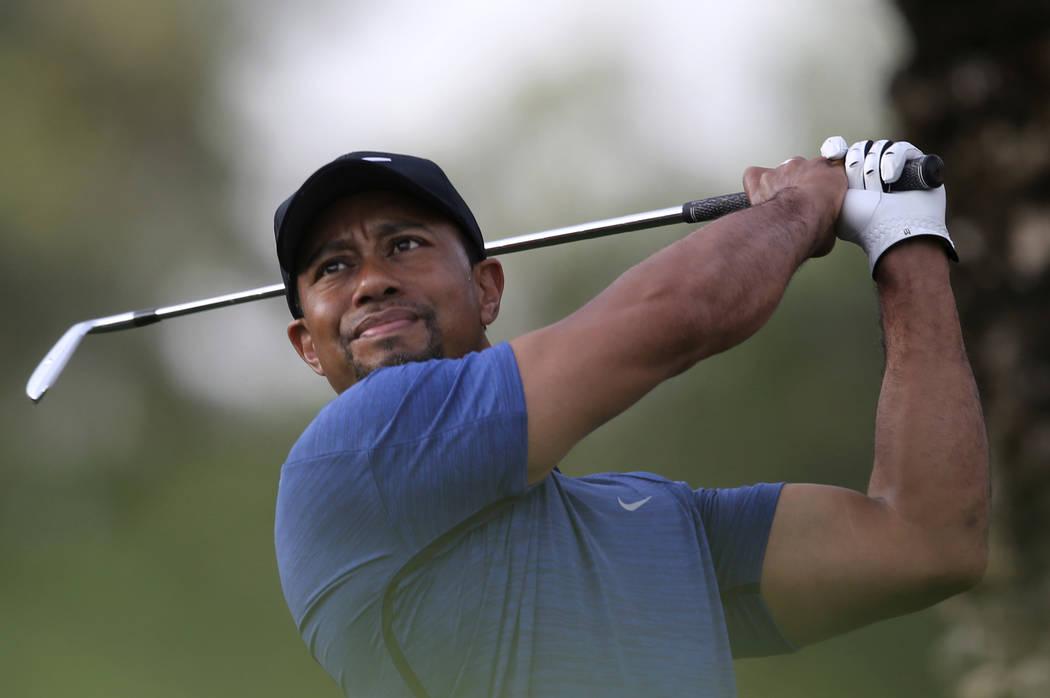 Tiger Woods tees off on the 11th hole during the first round of the Dubai Desert Classic golf tournament in Dubai, United Arab Emirates, Thursday, Feb. 2, 2017. (Kamran Jebreili/AP)