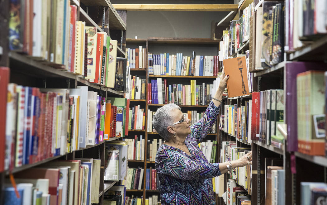 Amber Unicorn Books owner Myrna Donato has collected thousands of cookbooks over the past 35 years. Photo taken on Monday, March 20, 2017, at Amber Unicorn Books, in Las Vegas. (Benjamin Hager/Las ...