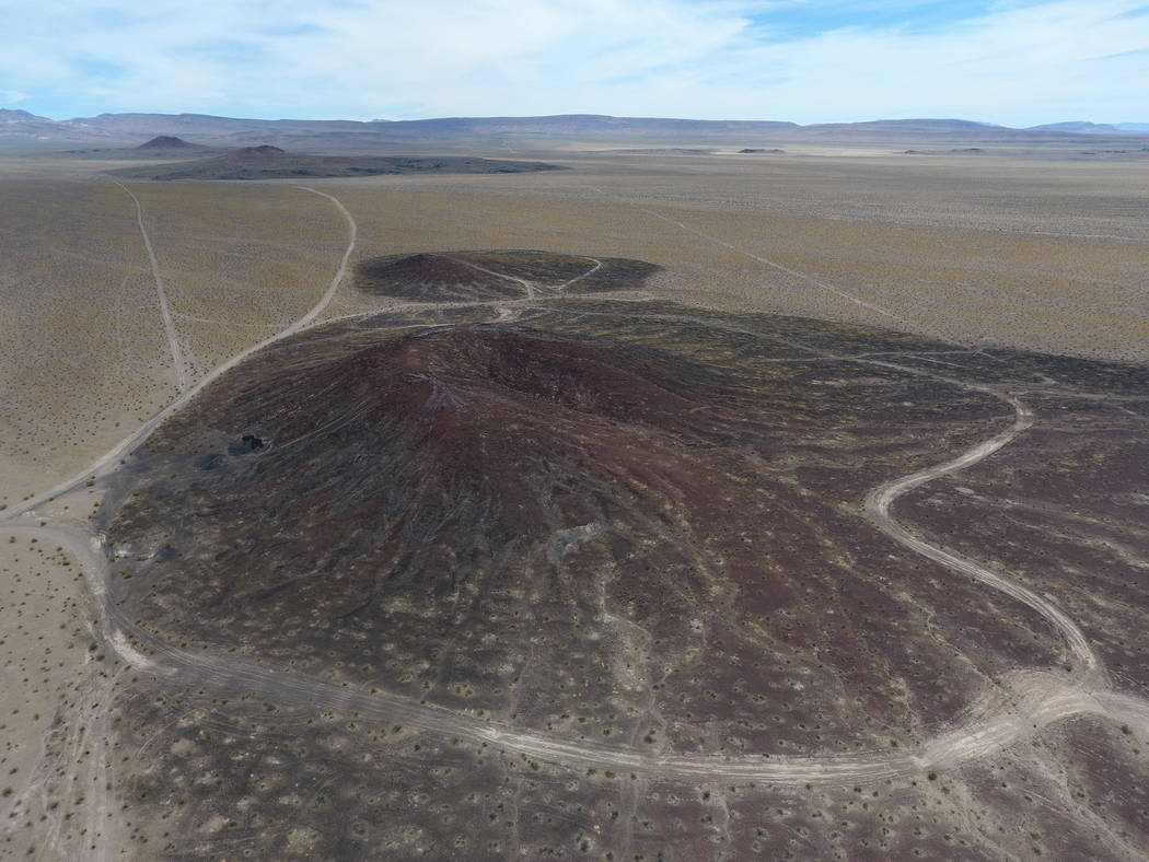 Little Cones, foreground, are two volcanic cinder cones that lie to the south of of Red Cone and Black cone, seen in the distance, in Crater Flat just west of Yucca Mountain, top center, on May 22 ...