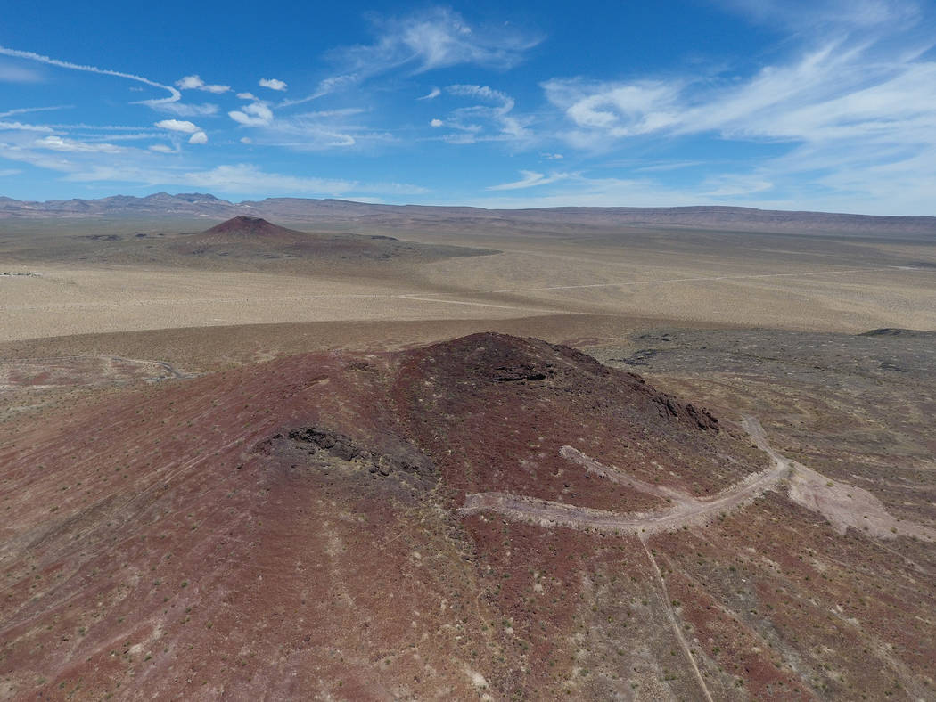 Red Cone and Black Cone, in the distance, are volcanic cinder cones in Crater Flat west of Yucca Mountain, right center, on May 22, 2017. Michael Quine/Las Vegas Review-Journal @Vegas88s