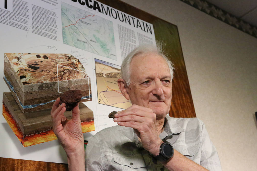 UNLV Emeritus Geology Professor Eugene Smith, a volcanism expert for the Nevada Nuclear Projects Agency scientific team, holds samples of volcanic rock from Crater Flat where he believes the possi ...