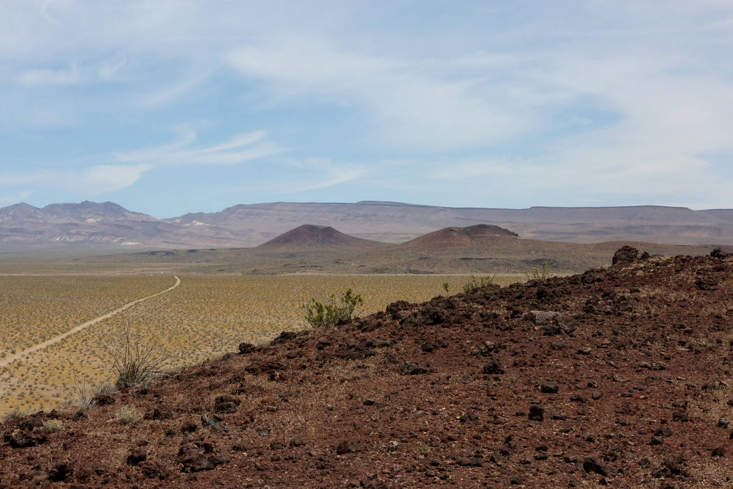 Black Cone, left, and Red Cone, seen in the distance from atop Little Cone, are volcanic cinder cones in Crater Flat that lie west of Yucca Mountain, on Monday, May 22, 2017. Michael Quine Las Veg ...