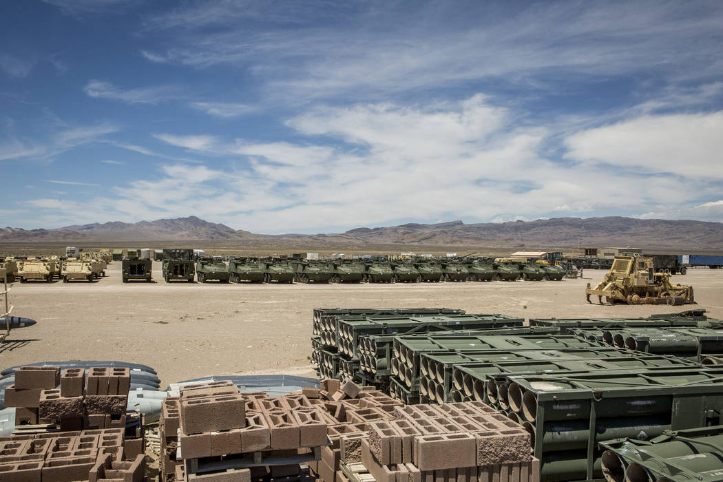 """At a storage lot jokingly referred to as """"K-Mart,"""" tanks and other vehicles wait tb prepped and deployed as targets on the Nevada Test and Training Range on Sunday, May 21, 2017. Patrick Connolly  ..."""