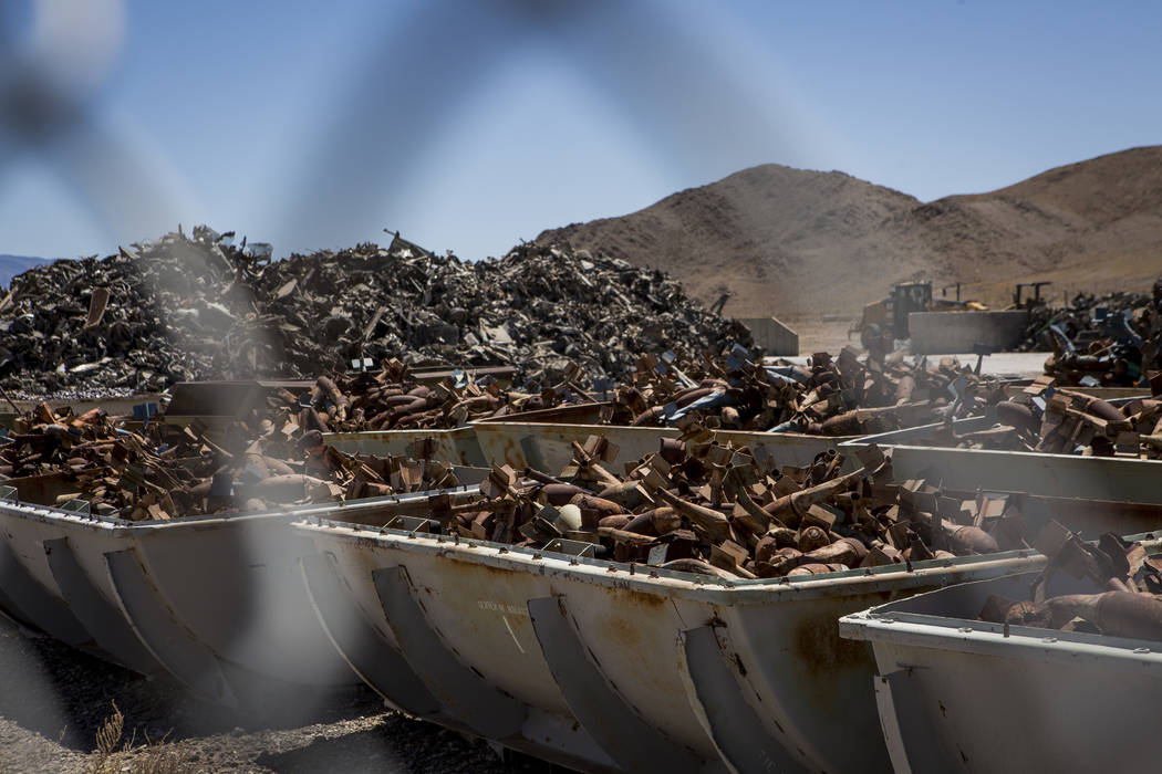 Piles of metal, formerly bombs and the vehicles they were dropped on, sit in bins at the Nevada Test and Training Range after being sorted and prepped to be sold as scrap metal. Patrick Connolly L ...