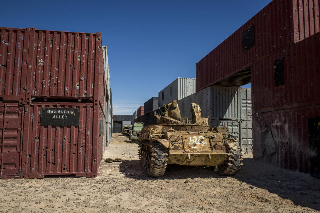 """An armored vehicle riddled with bullet holes waits in """"Damnation Alley,"""" where aircraft and ground troops practice attacks in an urban setting deep inside the Nevada Test and Training Range. Patri ..."""