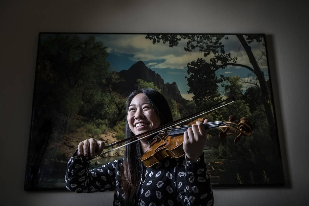 Violinist Kelsea Au has been named to Carnegie Hall's National Youth Orchestra, and will tour South America after training in New York. Photo taken on Wednesday, May 10, 2017, at Au's home, in Las ...