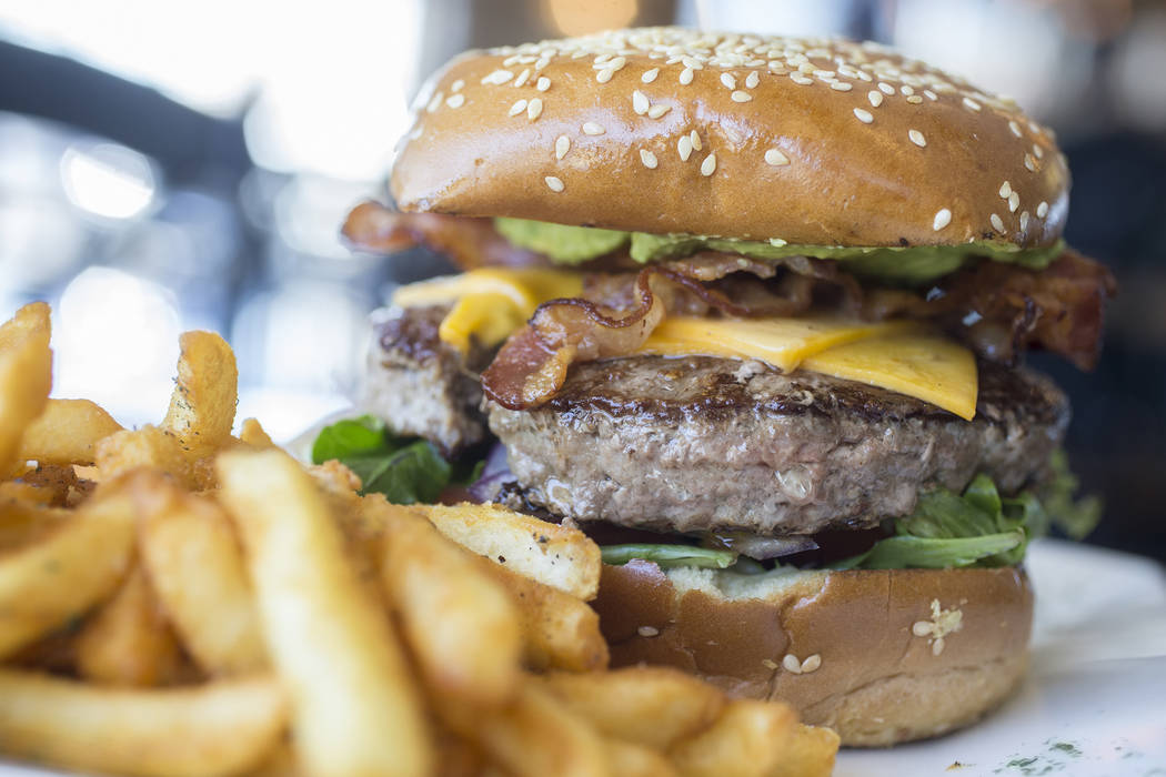 The dirty fork burger, with angus beef patty, avocado, bacon, tomato, sweet onion, lettuce, special sauce and fries at Dirty Fork on Tuesday, May 23, 2017, in Las Vegas. Benjamin Hager Las Vegas R ...