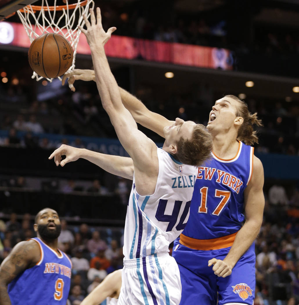 Charlotte Hornets' Cody Zeller (40) is fouled by New York Knicks' Lou Amundson (17) duyring the first half of an NBA basketball game in Charlotte, N.C., Wednesday, Nov. 11, 2015. (AP Photo/Chuck B ...
