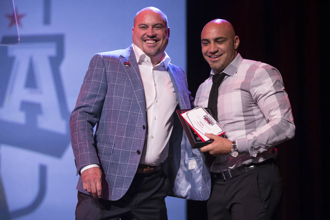 Tony Sanchez, left, head football coach for UNLV's football team, presents the award for Football Player of the Year Award to his brother Kenny Sanchez, head coach for the Bishop Gorman football t ...