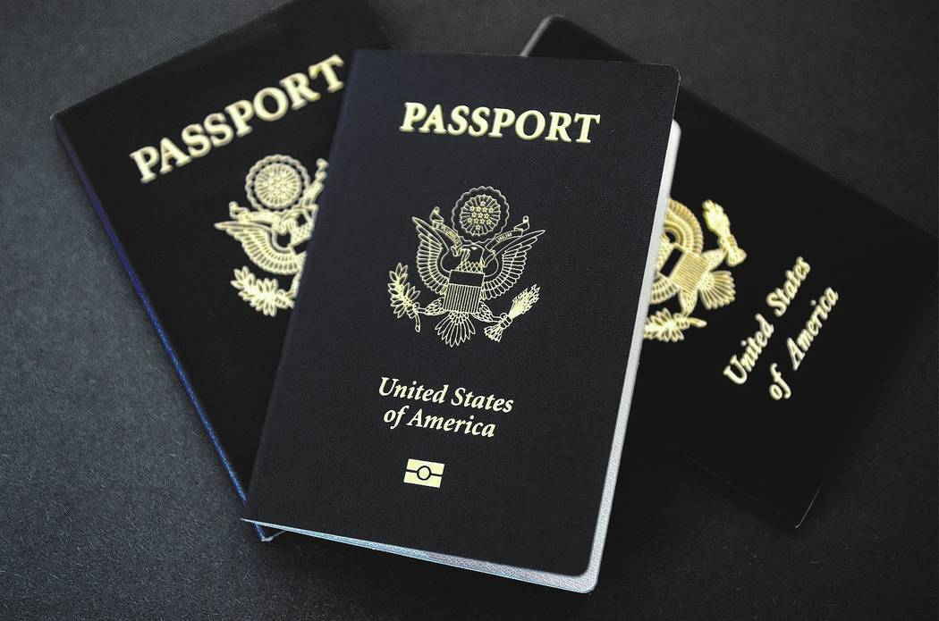 In this May 9, 2017 photo, U.S. passports lie on a table in Dallas, Texas. The U.S. State Department is in the middle of a record year for processing passport applications, with 20.5 million renew ...