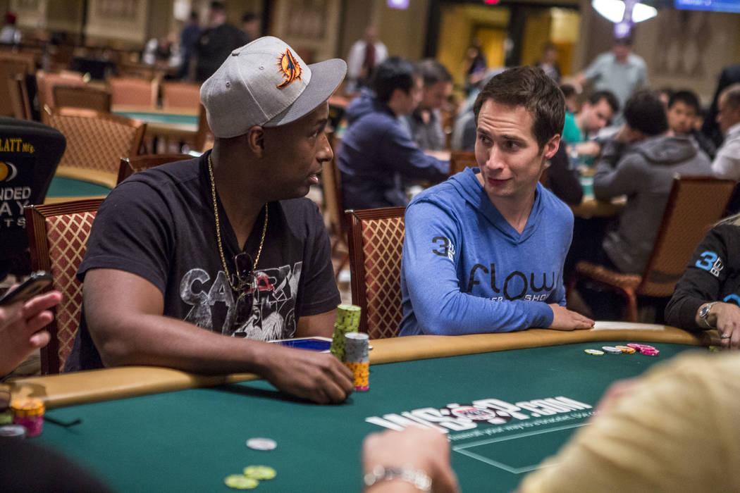 Jeff Gross talks with poker star Maurice Hawkins during a poker tag team event during the opening of the World Series of Poker at the Rio Convention Center on Wednesday, May 31, 2017. Patrick Conn ...