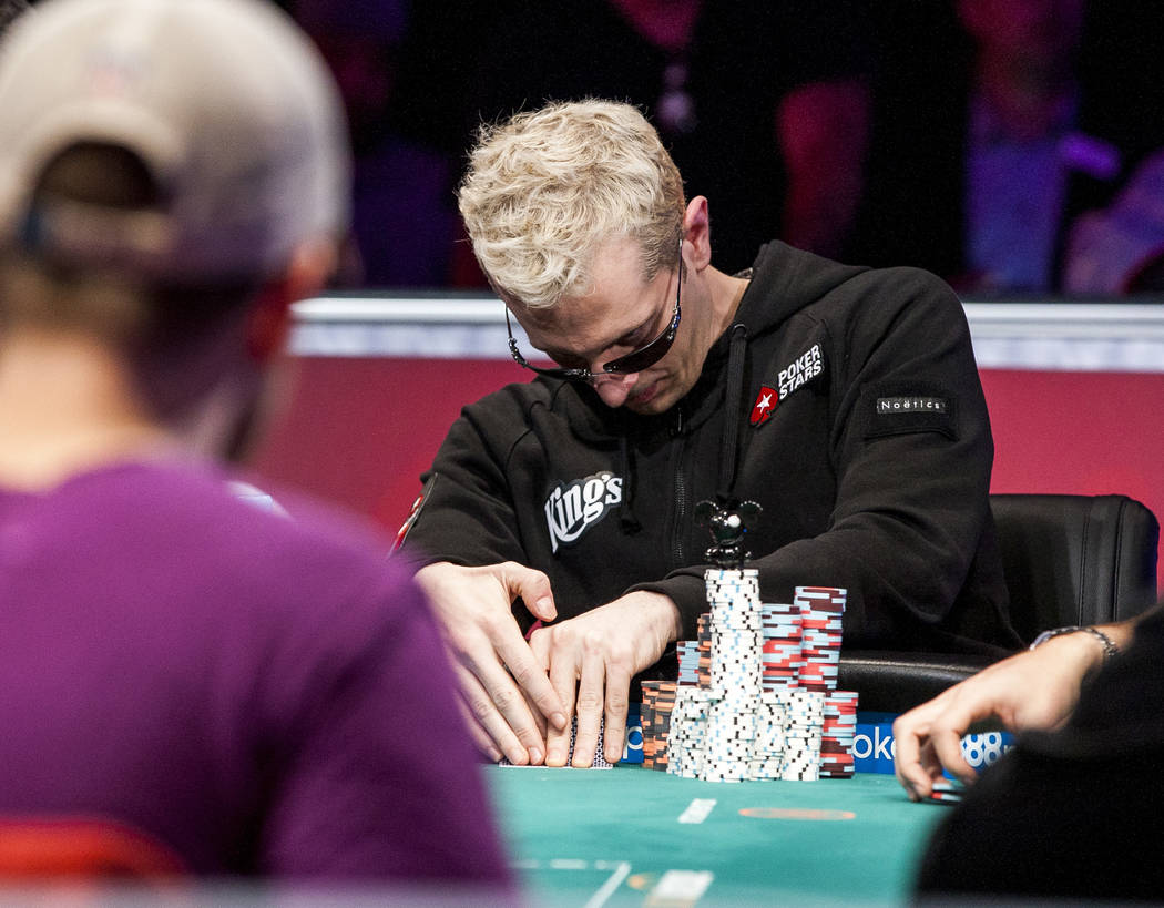 """Bertrand """"ElkY"""" Grospellier looks at his card in the World Series of Poker's $111,111 buy-in High Roller for One Drop No-limit Hold'em tournament at the Rio Convention Center on Monday, June 5 ..."""