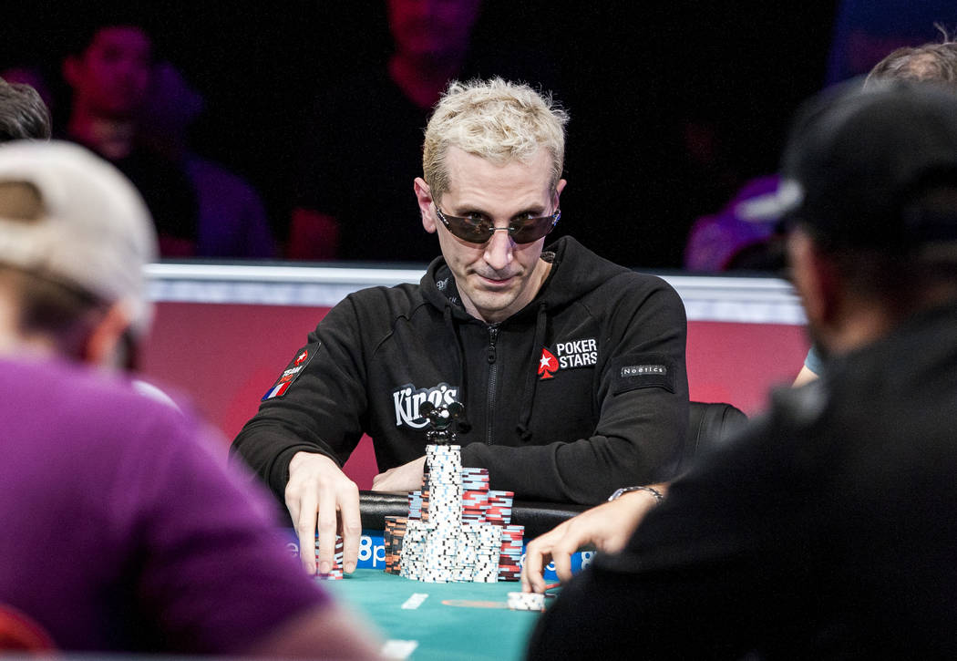 """Bertrand """"ElkY"""" Grospellier takes a glance around the table in the World Series of Poker's $111,111 buy-in High Roller for One Drop No-limit Hold'em tournament at the Rio Convention Center on  ..."""