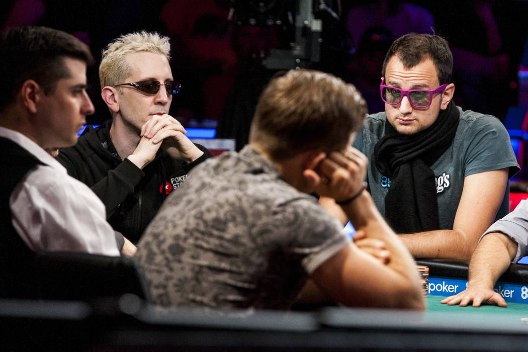 """Bertrand """"ElkY"""" Grospellier, left, and Rainer Kempe, right. compete in the World Series of Poker's $111,111 buy-in High Roller for One Drop No-limit Hold'em tournament at the Rio Convention Ce ..."""